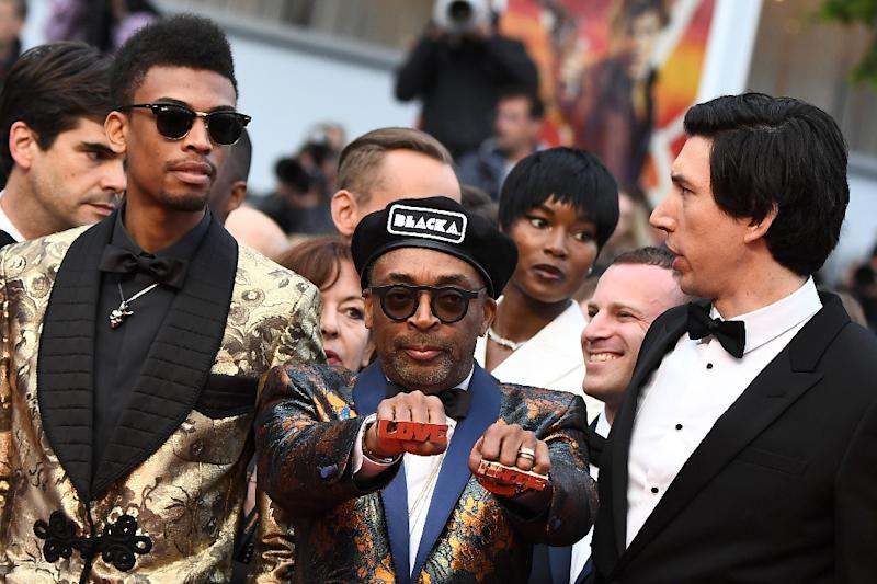 "Spike Lee dusted down his Love and Hate knuckleduster rings from ""Do the Right Thing"" for his ""BlacKkKlansman"" premiere (AFP Photo/Anne-Christine POUJOULAT            )"