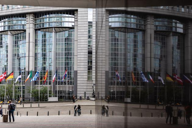 26 May 2019, Belgium, Brüssel: An entrance to the European Parliament is reflected in a glass façade. From 23 May to 26 May, the citizens of 28 EU states will elect a new parliament. Photo: Marcel Kusch/dpa (Photo by Marcel Kusch/picture alliance via Getty Images)
