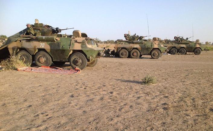 Three Chadian army armoured vehicles pointed across the Nigerian border in the direction of Gamboru from a position in Fotokol, Cameroon, on February 1, 2015 (AFP Photo/Stephane Yas)