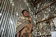 A resident of the Tigray town of Humera stands in a room riddled with bulletholes after the assault by Ethiopian forces