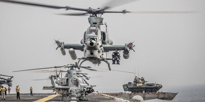 An AH-1Z Viper attached to Marine Medium Tiltrotor Squadron (VMM) 163 (Reinforced), 11th Marine Expeditionary Unit (MEU) takes off during a strait transit aboard the amphibious assault ship USS Boxer (LHD 4)