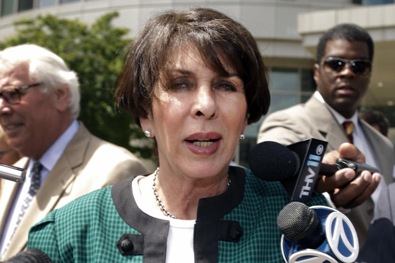 Former Arkansas State Treasurer Martha Shoffner leaves the Federal Court House in Little Rock, Ark., after a hearing Friday, May 31, 2013. A judge rejected a guilty plea from Shoffner who is accused of accepting cash from a broker. (AP Photo/Danny Johnston)