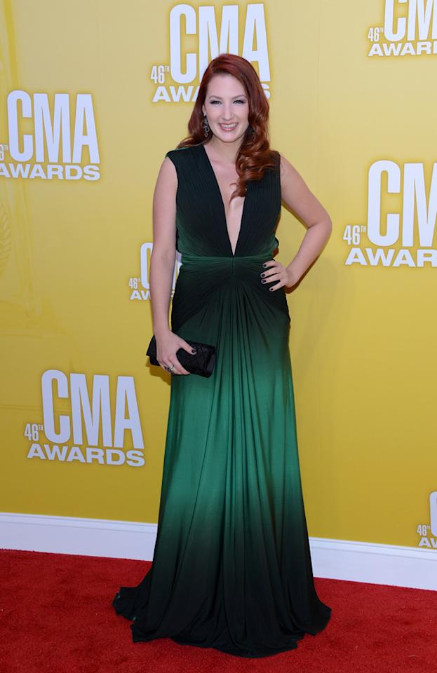 "<p class=""MsoNormal""></p><p class=""MsoNormal"">  <p class=""MsoNormal""><span style=""color:black;"">""Better in a Black Dress"" singer Katie Armiger was turned heads in a plunging emerald green gown, which perfectly set off her fiery red tresses. (11/1/2012)<br></span></p>"