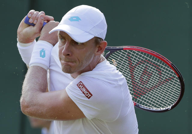 South Africa's Kevin Anderson returns to Serbia's Janko Tipsarevic in a Men's singles match during day three of the Wimbledon Tennis Championships in London, Wednesday, July 3, 2019. (AP Photo/Ben Curtis)