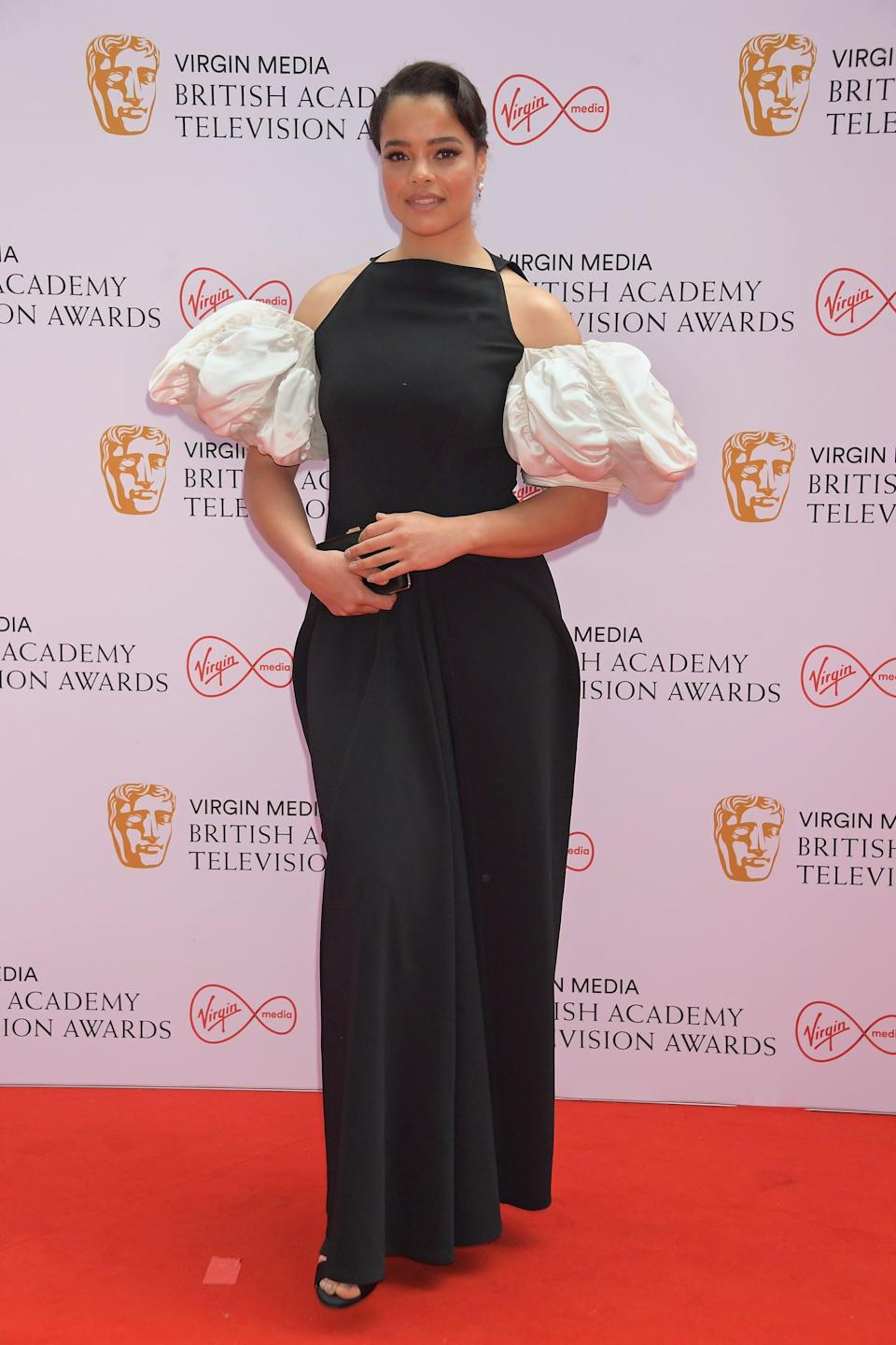 <p>Lydia West wore a black Loewe gown with white puff sleeves.</p>