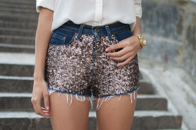 "<p><i>[Photo: <a href=""http://apairandasparediy.com/2013/07/diy-sequin-embellished-denim-shorts.html"">apairandasparediy.com]</a></i><br /></p>"