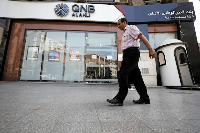 <p>A man walks in front of the QNB Alahli Bank, a branch of Qatar National Bank, in Cairo, Egypt June 6, 2017. (Photo: Mohamed Abd El Ghany/Reuters) </p>