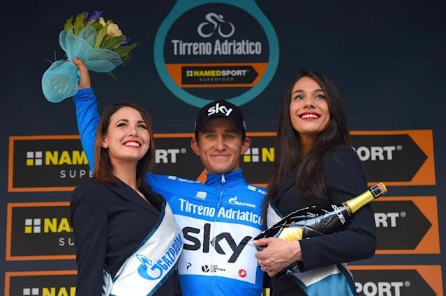 Poland's Michal Kwiatkowski celebrates on the podium the blue jersey of overall leader after the 5th stage of the Tirreno-Adriatico cycling race, from Castelraimondo to Filottrano, Italy, Sunday, March 11, 2018. (Dario Belingheri/ANSA via AP)