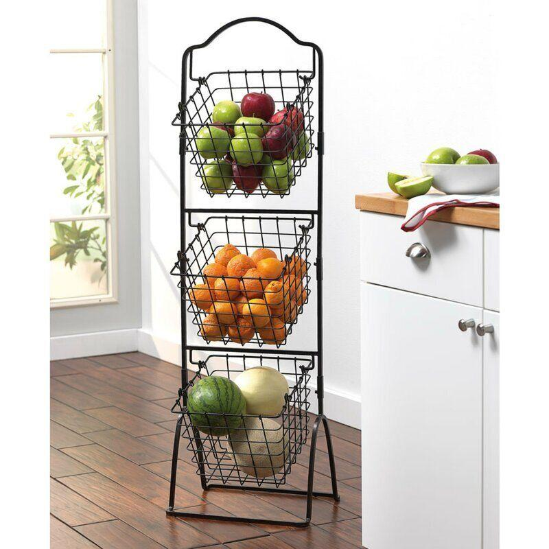 """Take the farmers market indoors with this three-tier metal basket that can hold all your fresh fruits and veggies. It has anantique black finish that will look better with a little wear.<a href=""""https://fave.co/34cPyNZ"""" target=""""_blank"""" rel=""""noopener noreferrer"""">Find it for $60 at Wayfair</a>."""