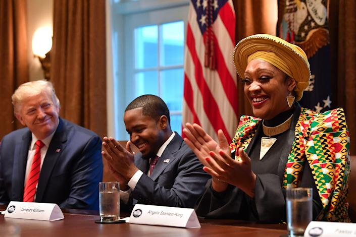 President Trump sits next to Terrence Williams and Angela Stanton-King during a meeting with African-American leaders at the White House in February. (Nicholas Kamm/AFP via Getty Images)