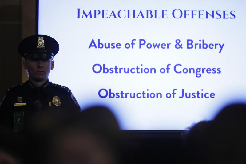 A list of impeachable offenses is on display during a hearing before the House Judiciary Committee on the constitutional grounds for the impeachment of President Donald Trump, on Capitol Hill in Washington, Wednesday, Dec. 4, 2019. (AP Photo/Andrew Harnik)