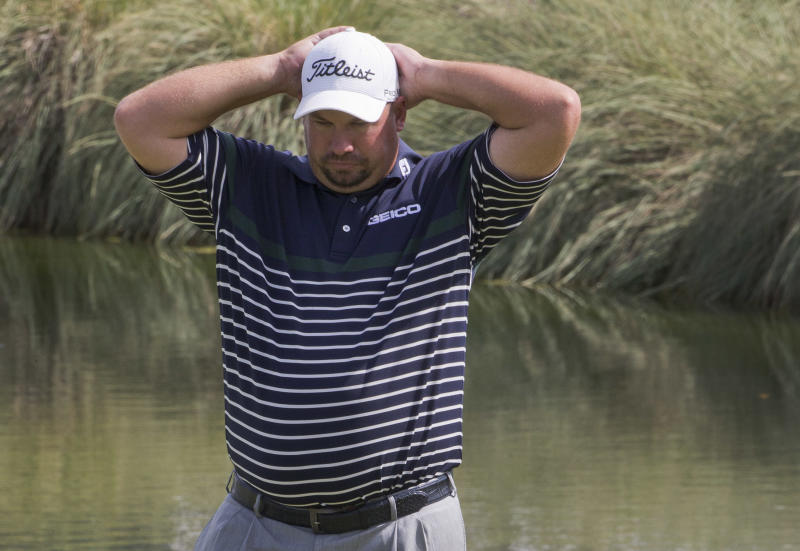 Brandon De Jonge lines up a putt on the 18th green in the first round during the Justin Timberlake Shriners Hospitals for Children Open golf tournament on Thursday, Oct. 4, 2012, in Las Vegas. (AP Photo/Julie Jacobson)