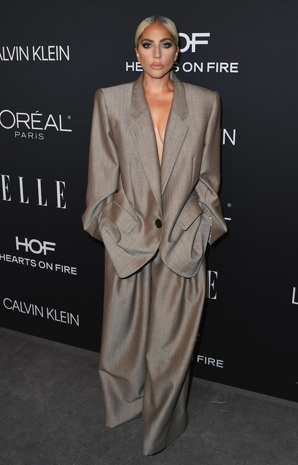 <p>Lady Gaga demonstrated how to up your workwear wardrobe this season in a slouchy suit by Marc Jacobs. <em>[Photo: Getty]</em> </p>