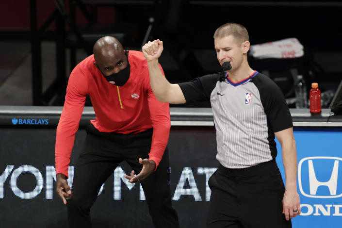FILE - In this Friday, Jan. 1, 2021, file photo, Atlanta Hawks head coach Lloyd Pierce reacts to a call by referee Tyler Ford during an NBA basketball game against the Brooklyn Nets, in New York. On Monday, March 1, 2021, Pierce was fired less than halfway into a season that began with heightened expectations but was beset by injuries. (AP Photo/Adam Hunger, File)