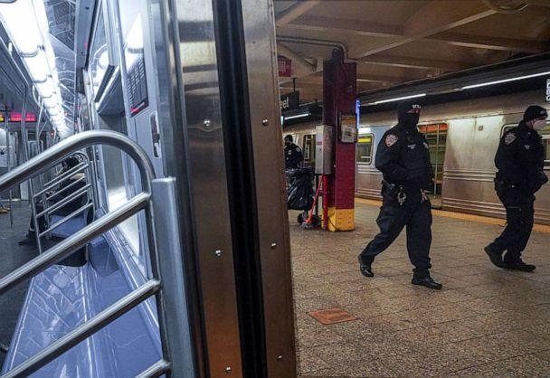 PHOTO: Police patrol the A line subway train bound to Inwood, after NYPD deployed additional officers into the subway system following deadly attacks, Feb. 13, 2021, in New York. (Bebeto Matthews/AP)