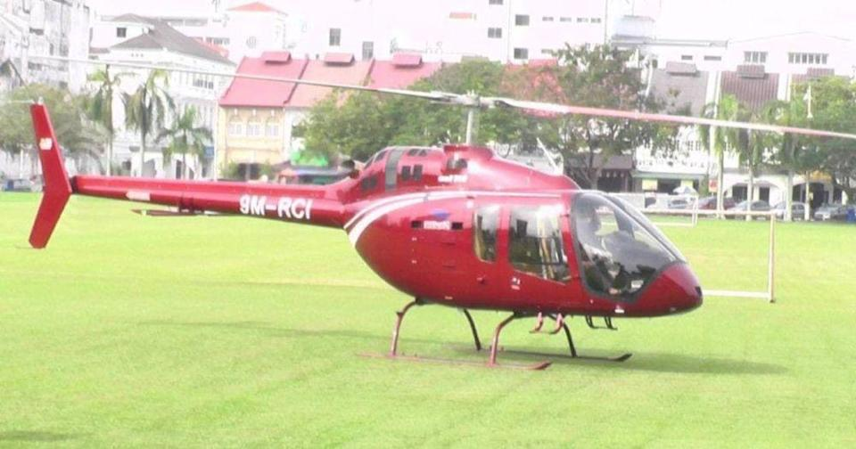 A helicopter landed at Padang Ipoh today to collect 36 packets of the city's famous Nasi Ganja.  — Picture via social media