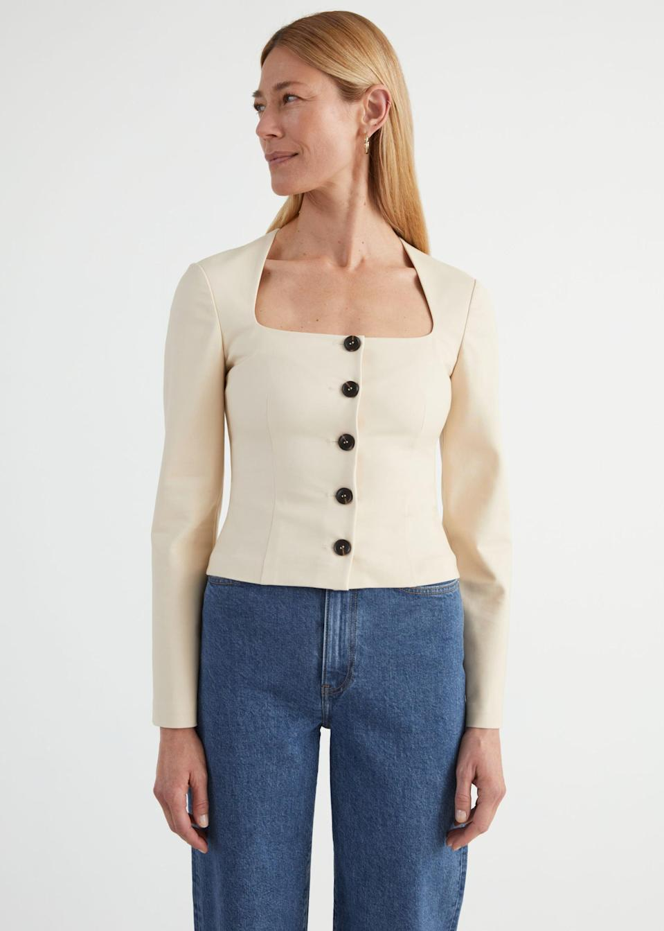 <p>This <span>&amp; Other Stories Fitted Buttoned Top</span> ($89) is so chic.</p>