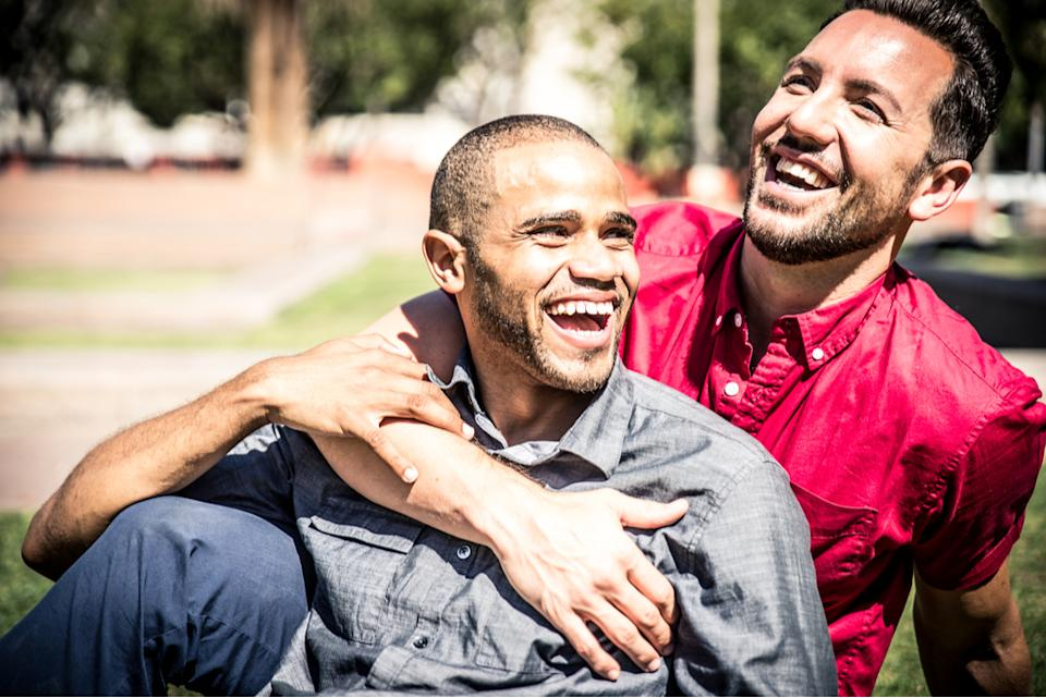 gay couple smiling, marriage advice from high school sweethearts