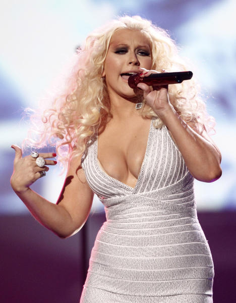 "FILE - This Nov. 20, 2011 file photo shows Christina Aguilera performing at the 39th Annual American Music Awards in Los Angeles. Aguilera is comparing her upcoming album to a ""rebirth."" With more than a decade in the music business behind her, the album will be a culmination of ""everything I've experienced up until this point,"" the pop star said, including divorce. The album doesn't have a release date and the title hasn't been announced. Aguilera, a coach on NBC's singing contest, ""The Voice,"" will perform the first single, ""Your Body,"" on the show on Sept. 17. (AP Photo/Matt Sayles, file)"