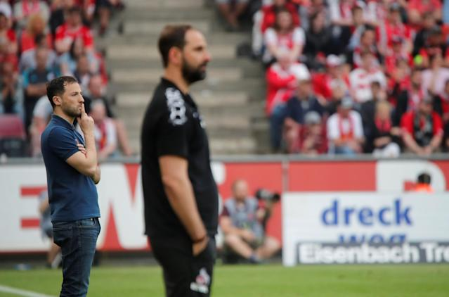 Soccer Football - Bundesliga - FC Cologne v Schalke 04 - RheinEnergieStadion, Cologne, Germany - April 22, 2018 Cologne coach Stefan Ruthenbeck and Schalke coach Domenico Tedesco REUTERS/Wolfgang Rattay DFL RULES TO LIMIT THE ONLINE USAGE DURING MATCH TIME TO 15 PICTURES PER GAME. IMAGE SEQUENCES TO SIMULATE VIDEO IS NOT ALLOWED AT ANY TIME. FOR FURTHER QUERIES PLEASE CONTACT DFL DIRECTLY AT + 49 69 650050