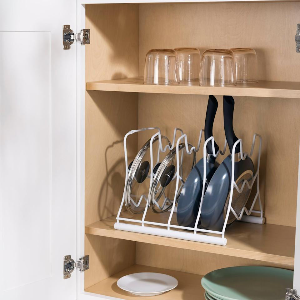 <p>Your pots-and-pans cabinet doesn't have to be a mess with this <span>Home Basics Pan Organizer Rack</span> ($24). You can stack your pans horizontally or vertically.</p>