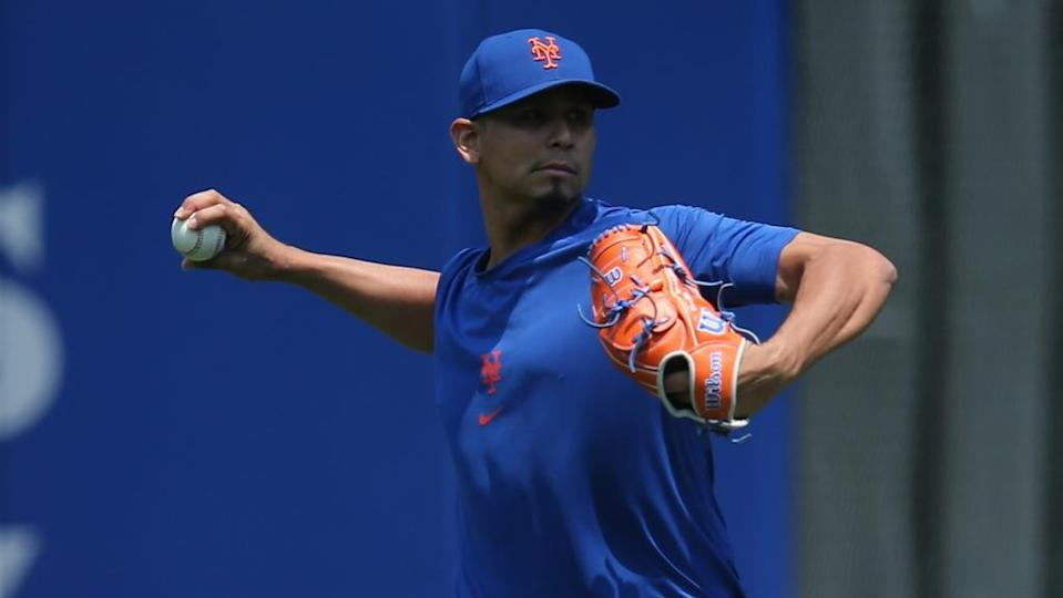 Mets injured starting pitcher Carlos Carrasco works out in the outfield in 2021
