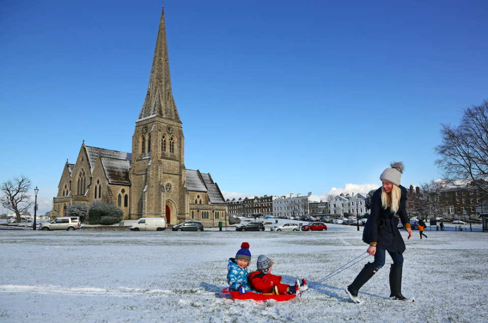 <em>Children like these youngsters in Blackheath, London, are experiencing a much more enjoyable day as hundreds of schools remain closed (Rex)</em>