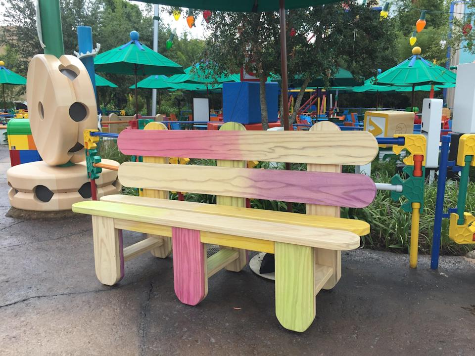 Benches made of popsicle sticks give Toy Story Land a whimsical touch.