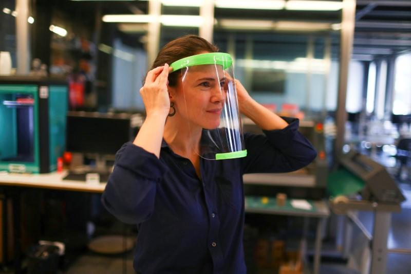 A technical staff tests a 3D printed protective visor made for healthcare professionals, amid the coronavirus disease (COVID-19) outbreak, at the Casa Firjan FabLab in Rio de Janeiro