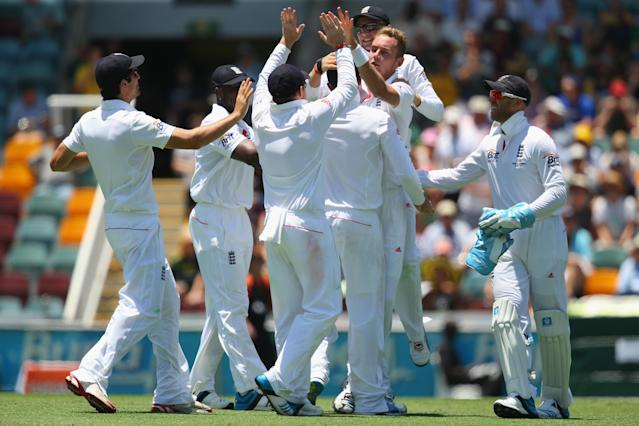 BRISBANE, AUSTRALIA - NOVEMBER 21: Stuart Broad of England celebrates with his team after taking the wicket of Shane Watson of Australia during day one of the First Ashes Test match between Australia and England at The Gabba on November 21, 2013 in Brisbane, Australia. (Photo by Mark Kolbe/Getty Images)