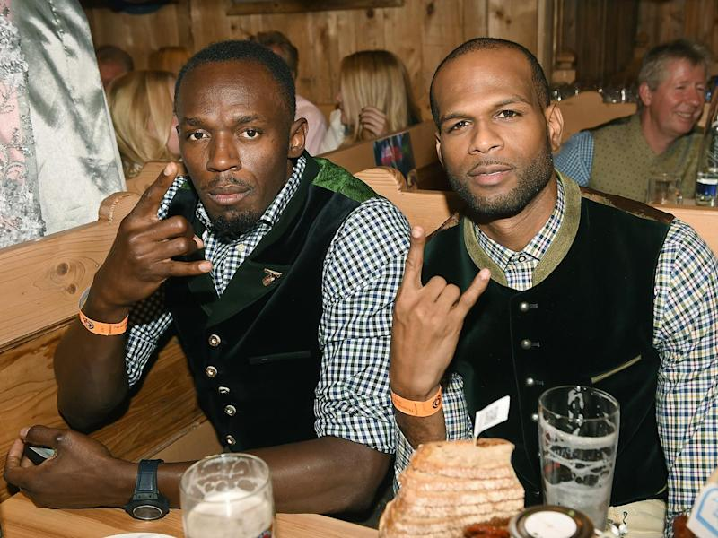Jamaican sprinter Usain Bolt and Jamaican-born British high jumper Germaine Mason during a visit to one of the beer tents of the 'Oktoberfest' in Munich, Germany (EPA)