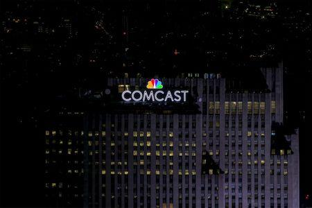 FILE PHOTO: The NBC and Comcast logo are displayed on top of 30 Rockefeller Plaza, formerly known as the GE building, in midtown Manhattan in New York July 1, 2015.   REUTERS/Brendan McDermid/File Photo