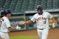 Houston Astros' Martin Maldonado (15) celebrates with Myles Straw (3) after hitting a home run against the San Francisco Giants during the sixth inning of a baseball game Monday, Aug. 10, 2020, in Houston. (AP Photo/David J. Phillip)