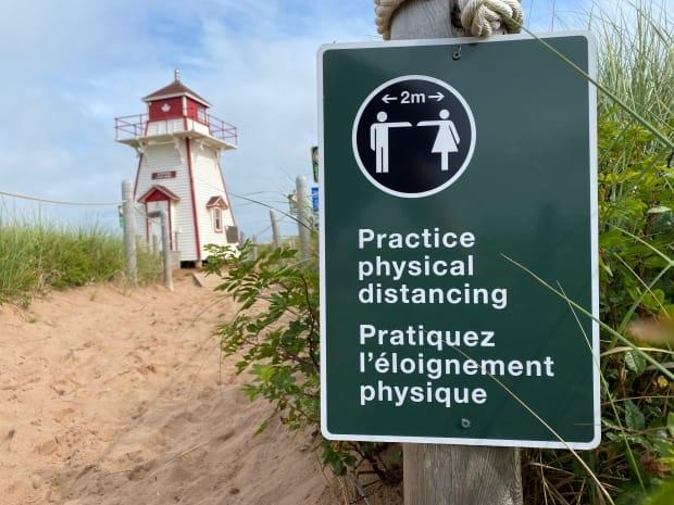 P.E.I. National Park put up signs last summer to help people keep an appropriate distance.   (John Robertson/CBC - image credit)