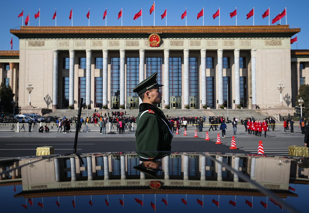 <p>A Chinese People's Liberation Army (PLA) soldier stands guard in front of the Great Hall of the People (GHOP) before the opening of the fifth Session of the 12th National People's Congress (NPC) in Beijing, China,March 5, 2017. (Photo: Roman Pilipey/EPA) </p>