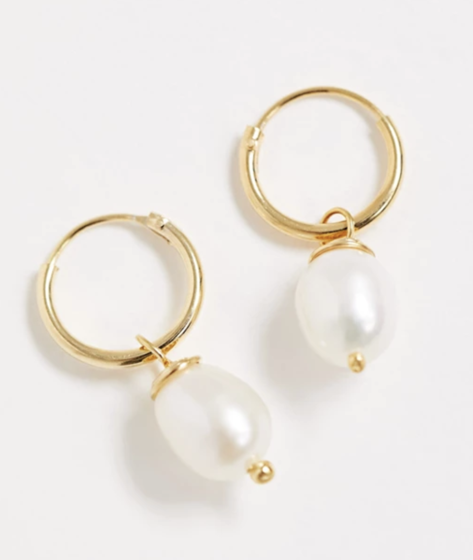 Sterling Silver with Gold Plate Hoop Earrings with Pearl Charm. Image via ASOS.
