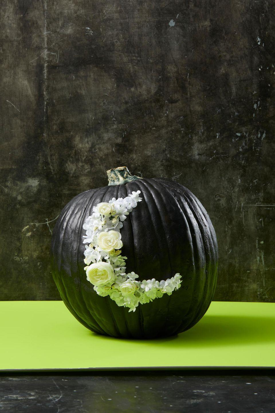 """<p>If your pumpkin carving skills could use some work, rely on fake flowers and paint to disguise any mistakes. First, paint a real or faux pumpkin black and use chalk to draw an outline of a crescent moon. Then, use an awl punch to punch a series of holes within the moon shape, keeping the holes a minimum of 1/2"""" apart. Wipe away the chalk outline, then poke faux flower stems into the holes.<strong><br></strong></p><p><a class=""""link rapid-noclick-resp"""" href=""""https://www.amazon.com/TEKTON-65731-Scratch-Punch-Awl/dp/B01BBLPPJW?tag=syn-yahoo-20&ascsubtag=%5Bartid%7C10055.g.238%5Bsrc%7Cyahoo-us"""" rel=""""nofollow noopener"""" target=""""_blank"""" data-ylk=""""slk:SHOP AWL PUNCHES"""">SHOP AWL PUNCHES</a></p><p><strong>RELATED: </strong><a href=""""https://www.goodhousekeeping.com/holidays/halloween-ideas/g2592/pumpkin-painting-ideas/"""" rel=""""nofollow noopener"""" target=""""_blank"""" data-ylk=""""slk:Beautiful Painted Pumpkin Ideas"""" class=""""link rapid-noclick-resp"""">Beautiful Painted Pumpkin Ideas </a></p>"""