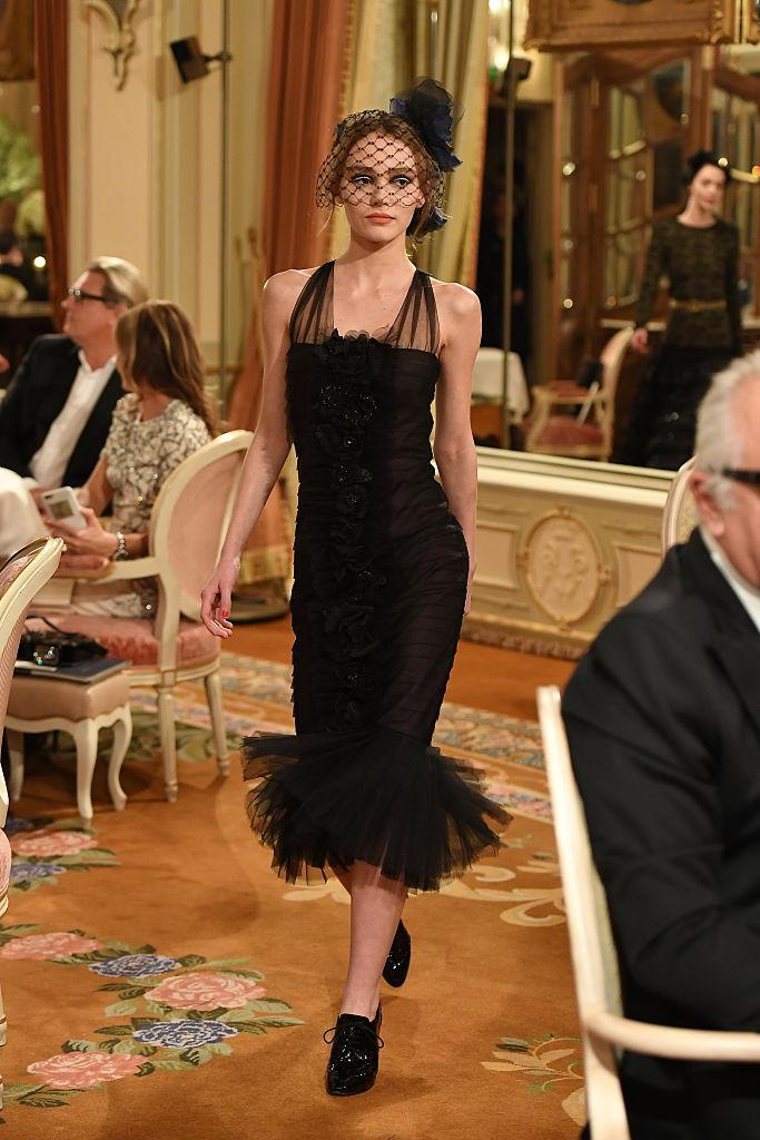 Lily-Rose Depp walks the runway during 'Chanel Collection des Metiers d'Art 2016/17 in December. (Photo: Getty Images)