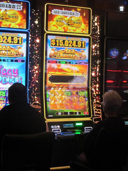 This June 4, 2021 photo shows gamblers playing slot machines at the Ocean Casino Resort in Atlantic City, N.J. Last year, Ocean, the former Revel casino, rose to third place out of nine casinos in terms of the amount of money won from in-person gamblers in Atlantic City. (AP Photo/Wayne Parry)