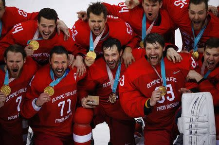 Ice Hockey - Pyeongchang 2018 Winter Olympics - Men's Final Game - Olympic Athletes from Russia v Germany - Gangneung Hockey Centre, Gangneung, South Korea - February 25, 2018 - Olympic Athletes from Russia pose with their gold medals. REUTERS/Brian Snyder