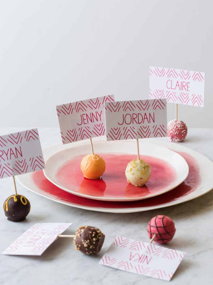 "<p>Dessert before dinner? Yes, please! A few store-bought or homemade truffles in a variety of fall colors are the key to this brilliant place card idea. </p><p><strong>Get the tutorial at <a href=""https://www.spoonforkbacon.com/truffle-place-cards/"" rel=""nofollow noopener"" target=""_blank"" data-ylk=""slk:Spoon Fork Bacon"" class=""link rapid-noclick-resp"">Spoon Fork Bacon</a>. </strong></p><p><strong><a class=""link rapid-noclick-resp"" href=""https://www.amazon.com/Inches-Letter-Sheets-Smooth-216gsm/dp/B00RU6IGAS?tag=syn-yahoo-20&ascsubtag=%5Bartid%7C10050.g.1538%5Bsrc%7Cyahoo-us"" rel=""nofollow noopener"" target=""_blank"" data-ylk=""slk:SHOP WHITE CARD STOCK"">SHOP WHITE CARD STOCK</a></strong></p>"