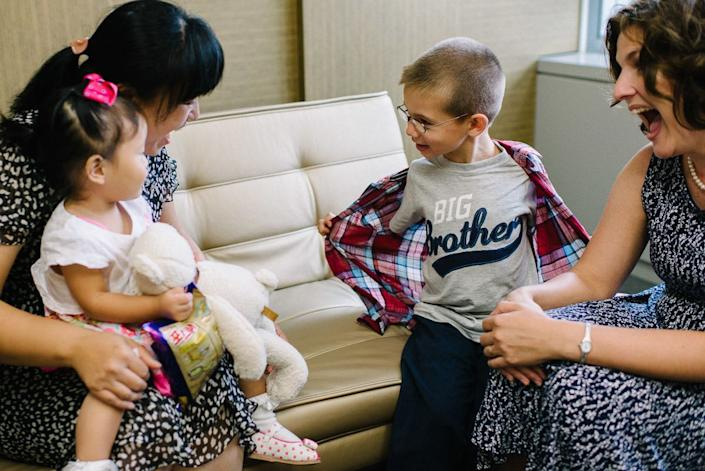 """""""A sweet, quiet, somewhat reserved baby girl, Lucy took a little while to open up to her new family. But when she did, <a href=""""http://www.welkinlight.com/seoul-adoption-photography-lucy/"""" target=""""_blank"""">it was smiles all around</a> and she took her new brother by the hand to show him around."""" -- Dylan Goldby"""