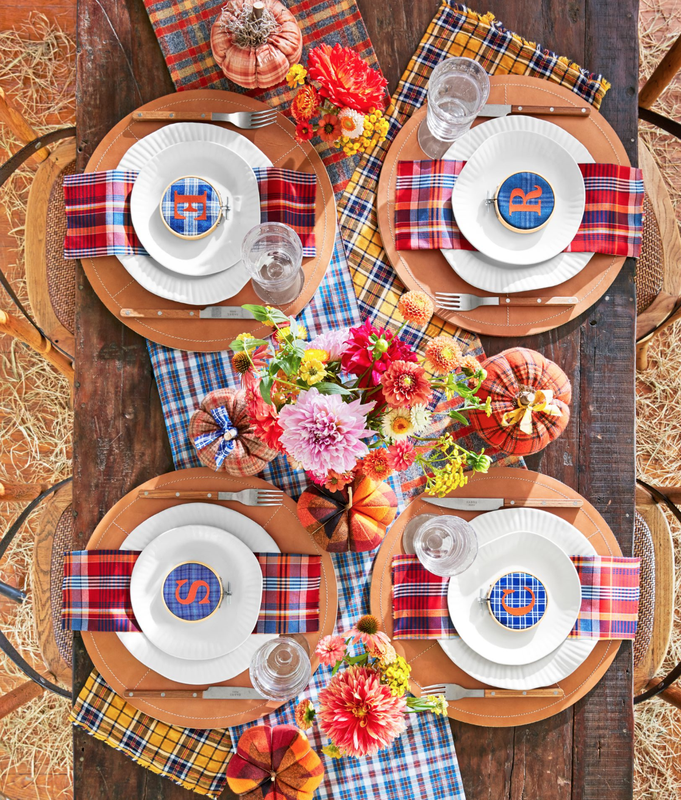 """<p>Plaid is the name of the game when it comes to Thanksgiving table decorating ideas. Here, personalized plaid place settings, plaid pumpkins, and even diagonal plaid runners add to the memorable holiday scene.</p><p><strong>Make the Place Settings:</strong> Use a 3-inch embroidery hoop to frame <a href=""""https://www.amazon.com/Michael-Miller-EO-087-Collection-Multicolor/dp/B005GRFJIK?tag=syn-yahoo-20&ascsubtag=%5Bartid%7C10050.g.1371%5Bsrc%7Cyahoo-us"""" rel=""""nofollow noopener"""" target=""""_blank"""" data-ylk=""""slk:plaid fabric"""" class=""""link rapid-noclick-resp"""">plaid fabric</a>. Iron on <a href=""""https://www.amazon.com/Camdon-Polyvinyl-Transfer-Letters-Orange/dp/B074PD6CHR?tag=syn-yahoo-20&ascsubtag=%5Bartid%7C10050.g.1371%5Bsrc%7Cyahoo-us"""" rel=""""nofollow noopener"""" target=""""_blank"""" data-ylk=""""slk:orange fabric initials"""" class=""""link rapid-noclick-resp"""">orange fabric initials</a> or affix cutout orange fabric with <a href=""""https://www.amazon.com/Mistyfuse-Misty-Yards-Fusible-Webbing/dp/B000PFPSJI?tag=syn-yahoo-20&ascsubtag=%5Bartid%7C10050.g.1371%5Bsrc%7Cyahoo-us"""" rel=""""nofollow noopener"""" target=""""_blank"""" data-ylk=""""slk:fusible webbing"""" class=""""link rapid-noclick-resp"""">fusible webbing</a>.</p><p><a class=""""link rapid-noclick-resp"""" href=""""https://www.amazon.com/Darice-Wood-Embroidery-Hoop-3/dp/B001B9I2ZY?tag=syn-yahoo-20&ascsubtag=%5Bartid%7C10050.g.1371%5Bsrc%7Cyahoo-us"""" rel=""""nofollow noopener"""" target=""""_blank"""" data-ylk=""""slk:SHOP EMBROIDERY HOOPS"""">SHOP EMBROIDERY HOOPS</a></p>"""