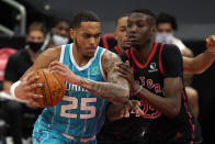 Charlotte Hornets forward P.J. Washington (25) runs into Toronto Raptors forward Chris Boucher (25, right) during the first half of an NBA basketball game Saturday, Jan. 16, 2021, in Tampa, Fla. (AP Photo/Chris O'Meara)