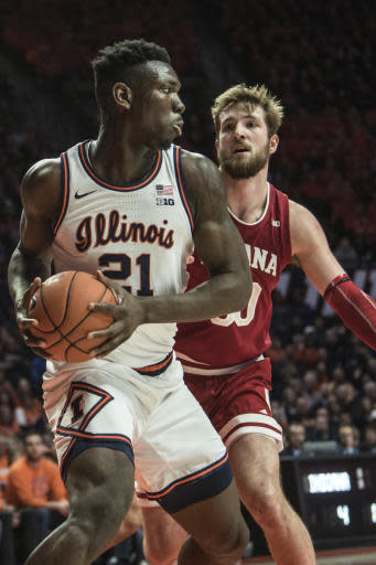 Illinois' Kofi Cockburn (21) brings down a rebound in front of Indiana's Joey Brunk, right, in the first half of an NCAA college basketball game Sunday, March 1, 2020, in Champaign, Ill. (AP Photo/Holly Hart)