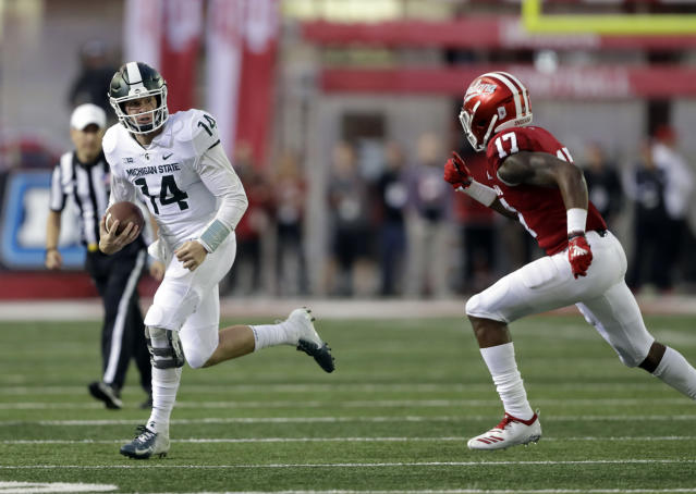 Michigan State quarterback Brian Lewerke is chased by Indiana's Raheem Layne during the first half of an NCAA college football game, Saturday, Sept. 22, 2018, in Bloomington, Ind. (AP Photo/Darron Cummings)