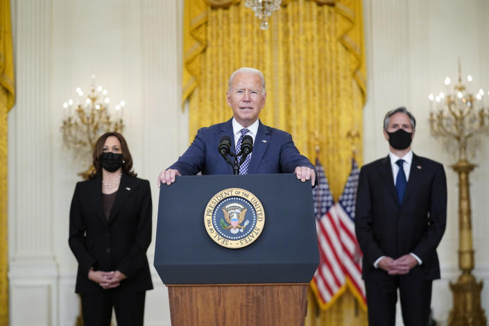 President Joe Biden speaks about the evacuation of American citizens, their families, SIV applicants and vulnerable Afghans in the East Room of the White House, Friday, Aug. 20, 2021, in Washington. Vice President Kamala Harris, left, and Secretary of State Antony Blinken, right, listen. (AP Photo/Manuel Balce Ceneta)