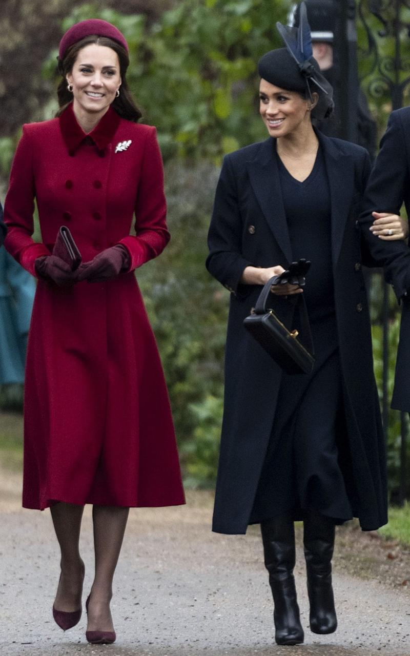 The Duchess of Cambridge and the Duchess of Sussex on Christmas day in 2018 - Getty