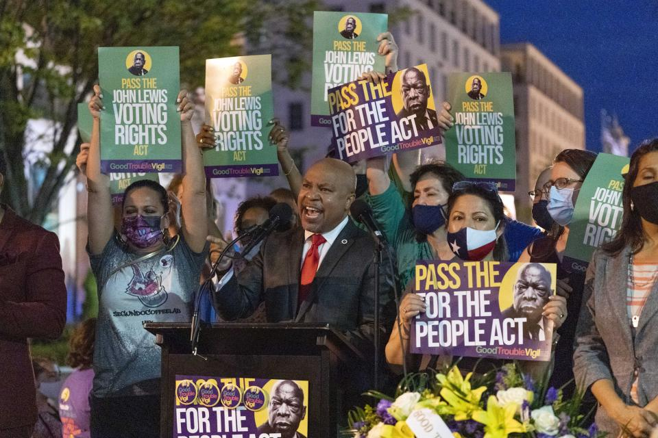 Texas State Rep. Carl Sherman and colleagues speaks during the Good Trouble Candlelight Vigil for Democracy supporting voting rights, at Black Lives Matter plaza in Washington, Saturday, July 17, 2021. (AP Photo/Jose Luis Magana)