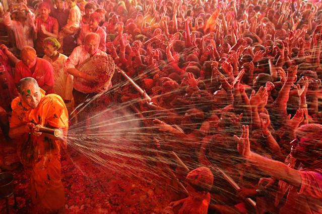 <p>Priest water gun on devotees on the occasion of Holi festival celebration at historical Govind Dev Ji temple , in Jaipur, Rajasthan, India on March 1,2018. (Photo: Vishal Bhatnagar/NurPhoto via Getty Images) </p>